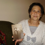 Descendant Suzette Cohen with photos of ancestors